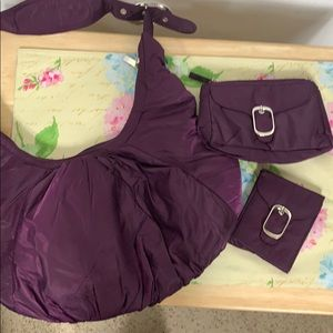 NWOT 3pc. Purple purse set, purse, sm bag, wallet